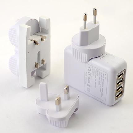 Универсальное зарядное устройство-переходник между розеткой и USB. Цвет корпусов белый